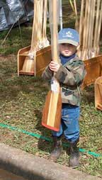 Little boy with canoe paddle