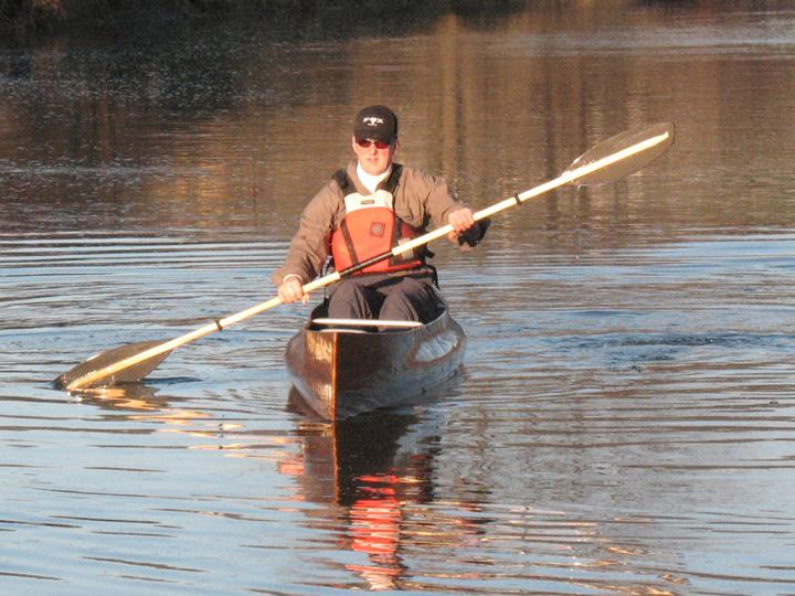 Solo canoe paddling with double blade paddle